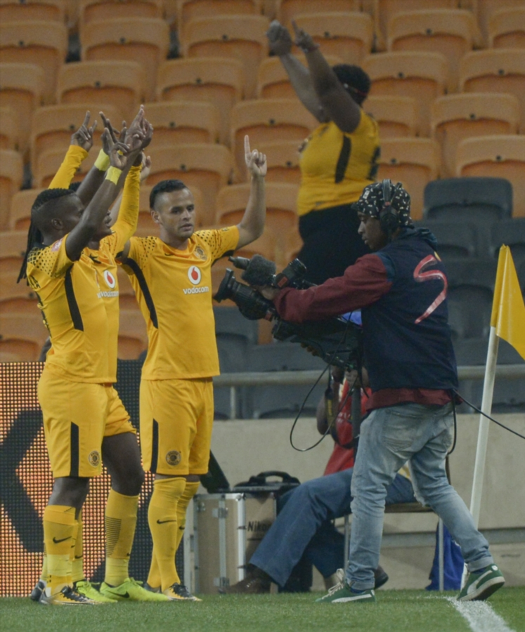 Kaizer Chiefs players celebrate with Siphiwe Tshabalala of Kaizer Chiefs after scoring a goal during the Absa Premiership match between Kaizer Chiefs and Bidvest Wits at FNB Stadium on September 16, 2017 in Johannesburg, South Africa.