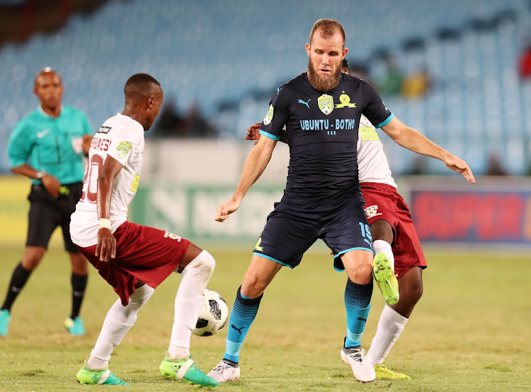 Mamelodi Sundowns' striker Jeremy Brockie shields ball from Tebogo Motshabisi and Bafana Dlamini of EC Bees during the Nedbank Cup Last 16 match at Loftus Versveld Stadium, Pretoria on 13 March 2018.
