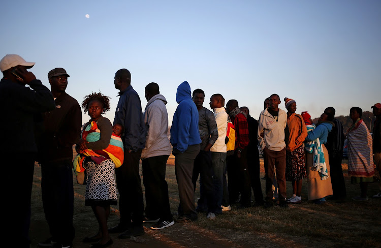 Zimbabwean voters queue to cast their ballots in the country's general elections in Harare on July 30 2018. The MDC Alliance went to court on Friday to legally challenge the results.
