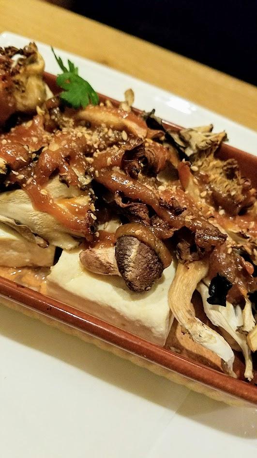 Chef Naoko's Shizuku hot small plate during dinner of vegan Miso Glazed Ota Tofu with Oregon Mushrooms, one of half a dozen hot small plates available