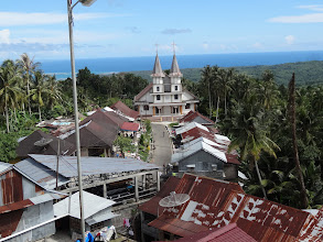 Photo: Another view of that large church nearthis tribal village of Hari Kelima with the beautiful Indian ocean in the back ground.