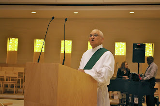 Photo: Deacon Raymond Derouen led the prayers of petition on Saturday.