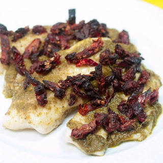 Tilapia with Pesto and Sun-Dried Tomatoes.
