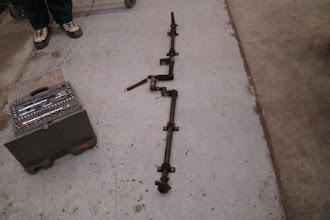 Photo: Brake linkage assembly removed from CBL for cleaning and inspection. Bottom end of assembly in picture operates the left-side brakes.