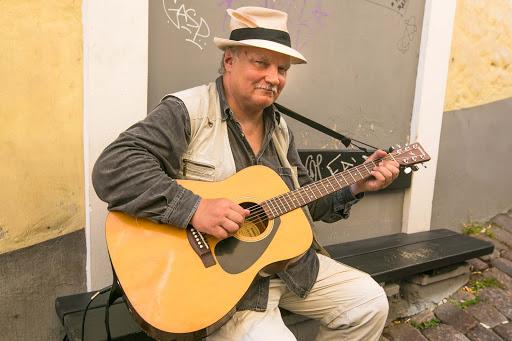 tallinn-street-musician.jpg - A street musician pauses for a visitor in Old Tallinn.
