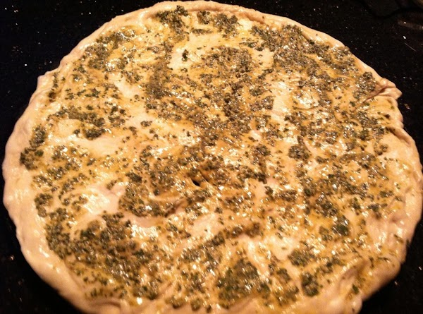 STRETCH DOUGH ONTO PIZZA STONE  N COMBINE PESTO N CREAM TOGETHER IN SMALL...
