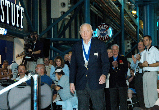 Former astronaut John Glenn Jr. is greeted with applause as he is introduced as a previous inductee.