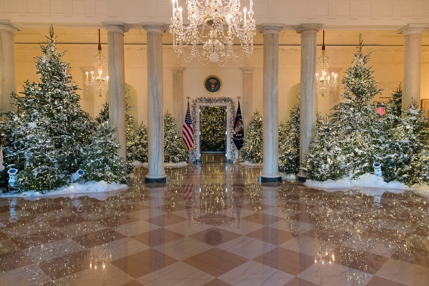 Melania looks over all the decorations.