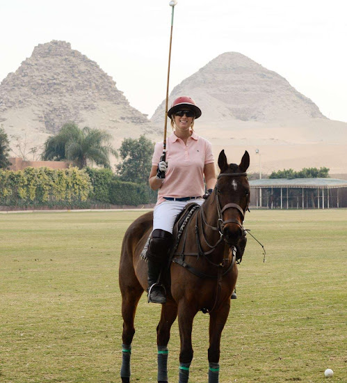 expat woman playing polo in egypt overlooking the abu seir pyramids in cairo egypt