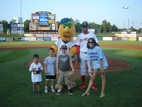 Photo: Kasey poses with BlueClaws player and mascot and other kids who threw out pitches.