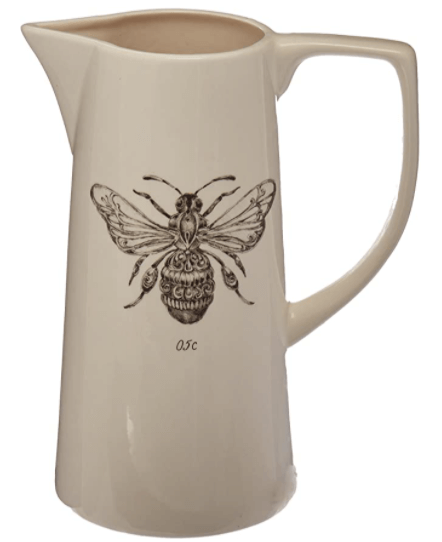 spring decorations ideas white ceramic pitcher with bee detail