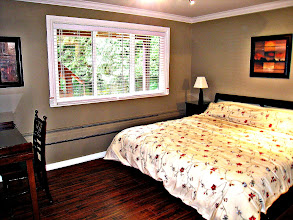 Photo: GARDEN LEVEL MASTER BEDROOM WITH KING BED -  OVERLOOKS BACK YARD