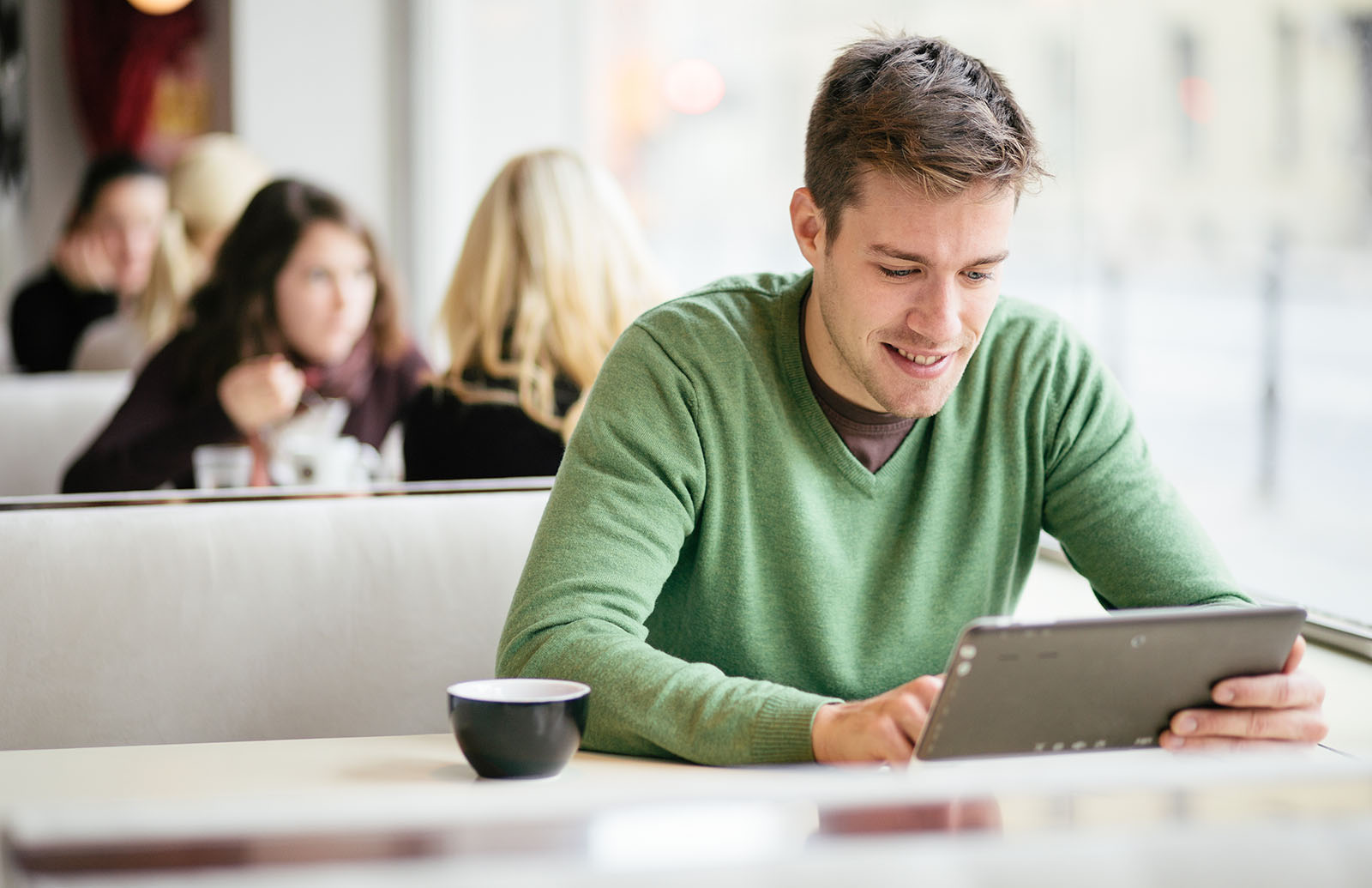 Student looking up information on a tablet computer