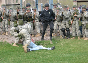 Photo: Soldiers detain a mock-rioter during a civil disturbance exercise the 34th Military Police Company conducted with the Stillwater Police Department Apr. 22 in Stillwater, Minn.