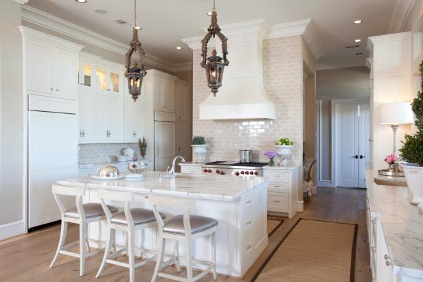 Neutral Open Kitchen With White Island and Brown Lantern Pendants