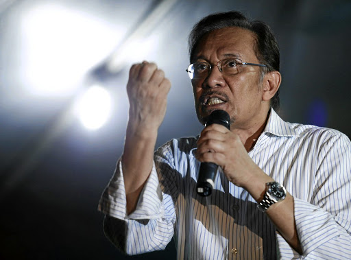 Malaysian opposition leader Anwar Ibrahim, jailed in 2015, speaks during an election campaign in Kuala Lumpur in April 2013. Picture: REUTERS