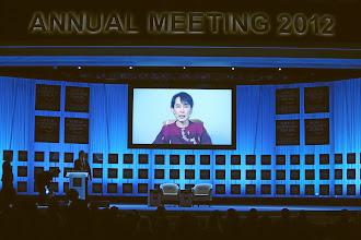Photo: DAVOS/SWITZERLAND, 26JAN12 - Aung San Suu Kyi (on screen) addresses the World Economic Forum Annual Meeting 2012 in Davos, Switzerland, January 26, 2012.  Copyright by World Economic Forum swiss-image.ch/Photo by Sebastian Derungs