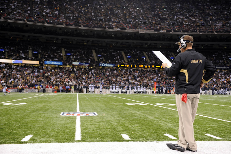 Photo: November 21, 2010; New Orleans, LA, USA;  New Orleans Saints head coach Sean Payton calls in a play from the sidelines against the Seattle Seahawks during the second half at the Louisiana Superdome. The Saints won 34-19. Mandatory Credit: John David Mercer-US PRESSWIRE