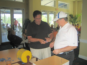 Photo: Picking a ticket for the Raffle