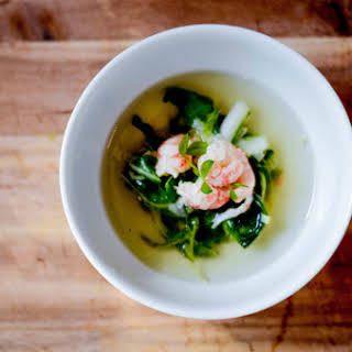 Seafood Consomme With Langoustine And Spring Vegetables.
