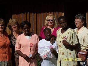 Photo: Team members with women who where given badages made in the US