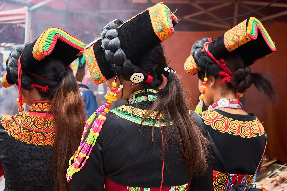 Yi women in traditional dress at the Shaxi Singing Festival - Shibaoshan Yunnan China