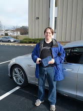 Photo: Me in front of my new car