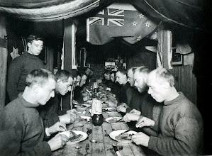 """Photo: cena a mediados del invierno, 22 de junio de 1915: """" cena a las seis, cerdo asado, compota de manzanas y guisantes en conserva, con budinde ciruela """" ( diario de McNish )"""