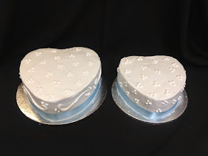 Photo: Heart shaped wedding cakes.  Custom design on left, 3-dot cluster on right. Light blue satin ribbon trim.
