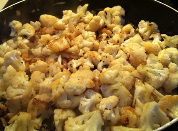 Remove pancetta from pan, add onions and cook about 2 minutes. Stir in cauliflower...