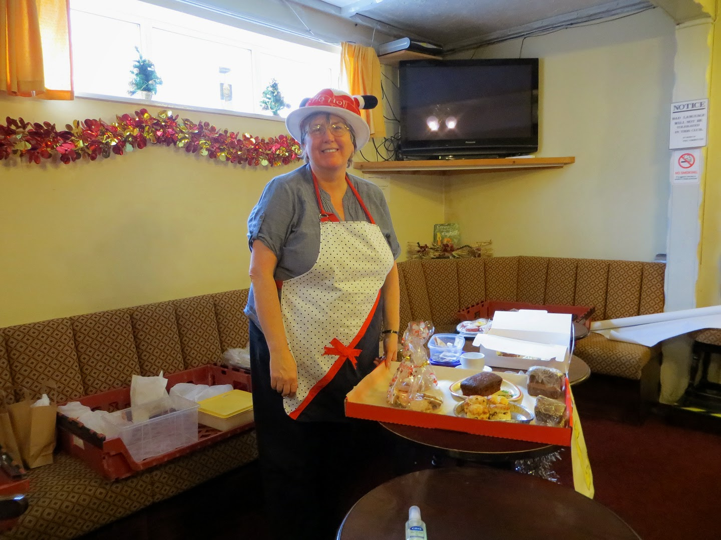 Photo: Sheila looking after the cake stall before singing with the choir