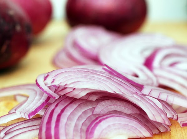 In a medium saucepan, heat oil over medium-low heat. Add onions and sauté until...