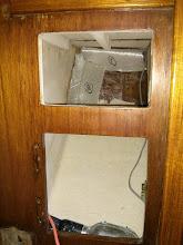 Photo: test fitting cloth along bulkhead and between horizontal shelf and hull.
