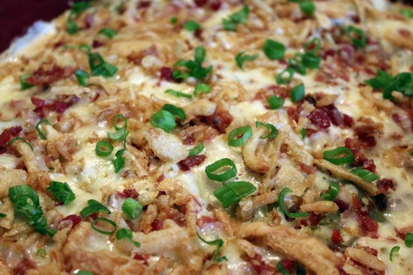 Scallions sprinkled on top of baked casserole.