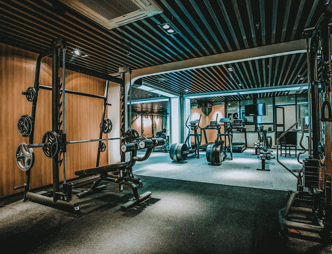 Gym image with smith machine and elliptical trainer machines