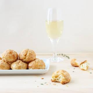 Champagne, Comté, and Fresh Thyme Gougères.