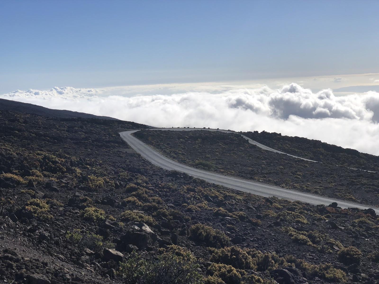 Biking Haleakala Volcano  - hairpins, volcano, sky and clouds