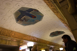 Photo: View of the ceiling at the Novokuznetskaya station. The mosaic of a Soviet fighter pilot standing on his plane. https://en.wikipedia.org/wiki/Novokuznetskaya