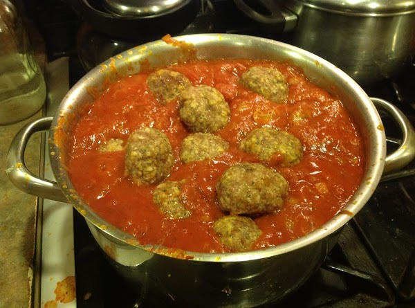 Add the meat balls or sausage and grated Cheese, stir & continue to cook...