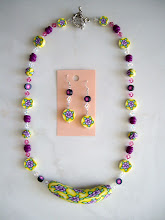 "Photo: PCF- 102Necklace and earrings set. Polymer Clay rose and leaf cane beads and crystal beads. 22"", $89.00"