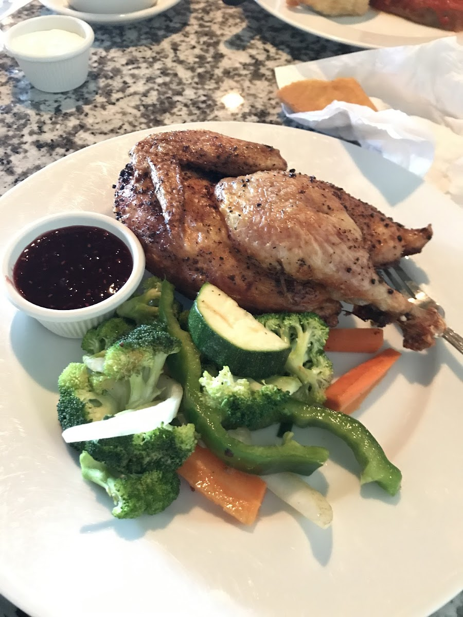 Half Bird with raspberry sauce. The chicken is so crispy on the outside and tender on the inside.