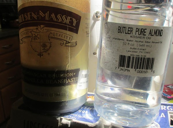 Add each of the extracts to a cup larger than a 2 cup measure,...