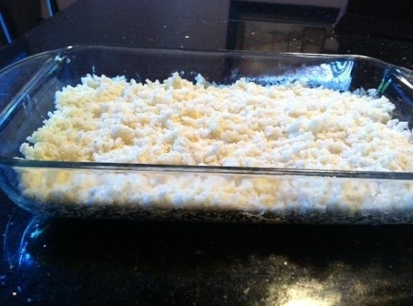 I USED AN 11X7 GLASS BAKN DISH. PUT 1/2 OF RICE MIXTURE INTO BAKN...