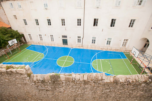 Dubrovnik-basketball-court.jpg - A paved basketball court provided a contrast to centuries-old buildings in Old Dubrovnik.