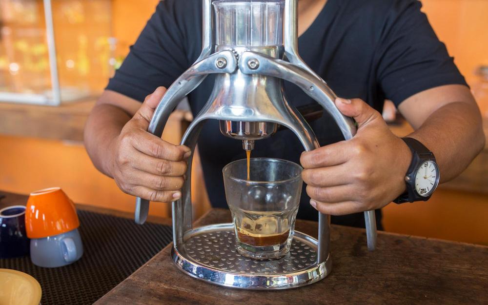 barista pressing out cold-press espresso