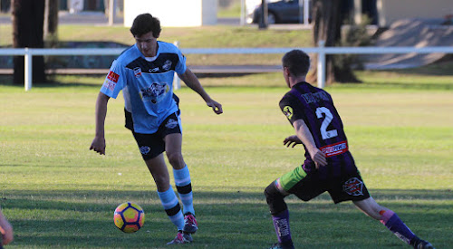 Narrabri FC attacking midfielder Toby Sunderland takes on Crossroads Eleven FC's Josh Boyd. Sunderland was the man-of-the-match in his first game in two years on Saturday.