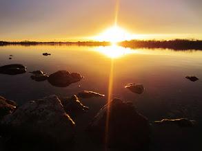 Photo: Sunset over lake rocks at Eastwood Park in Dayton, Ohio.
