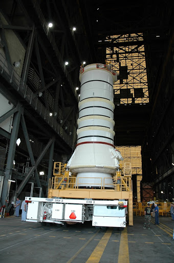 The right aft booster rolls into the transfer aisle of the Vehicle Assembly Building it will be lifted onto the mobile launcher platform.