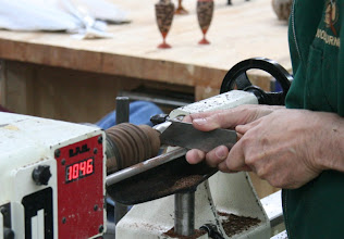 Photo: Allen uses a parting tool to cut the top flat.