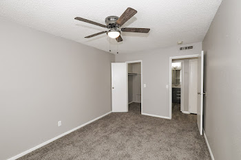 A2 bedroom with neutral walls and carpet and ceiling fan